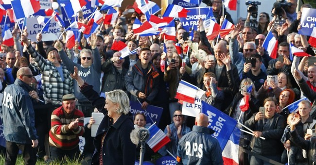 """The Latest: Singer Doherty: Le Pen not """"a distant threat"""""""
