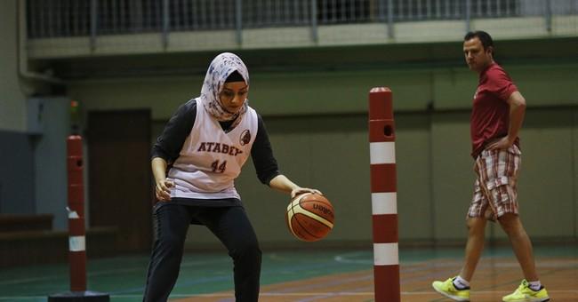 International basketball celebrates vote to allow headgear