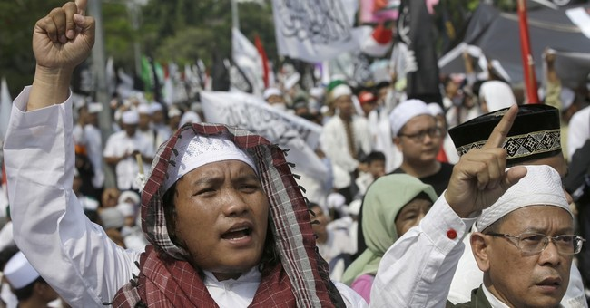 Indonesia hard-liners call for jailing of Christian governor