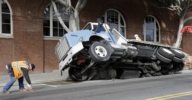 The Latest: Crews find 3-feet deep 'void' where street caved