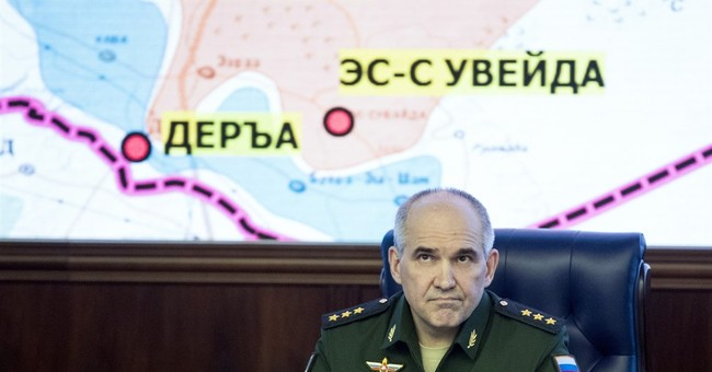 The Latest: Russia-backed Syria deal enters into effect