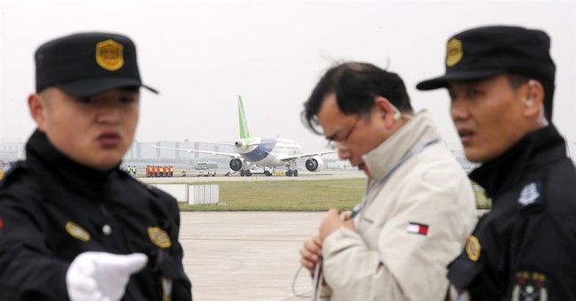 1st large Chinese-made passenger jet makes its maiden flight