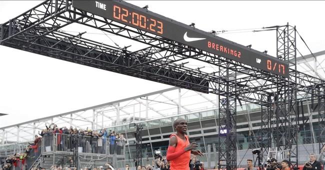 Kipchoge falls 26 seconds short of first sub 2-hour marathon