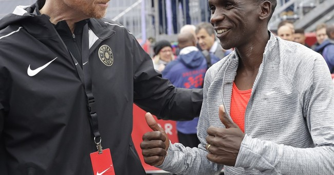 Kipchoge falls 26 seconds short of first sub 2-hour marathon