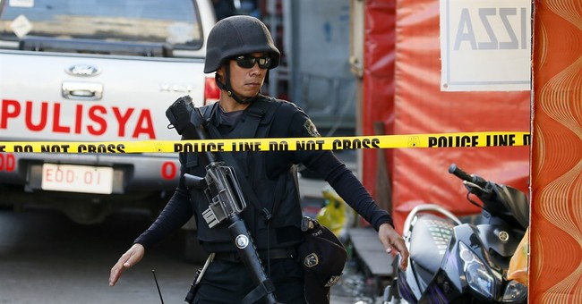 Philippines says bomb sparked by feud but IS claims attack