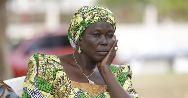 Nigeria leader meets Chibok girls, leaves for medical trip