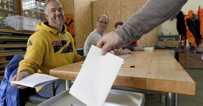 The Latest: Merkel party leads in warm-up for national vote