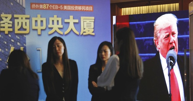 Trump in-laws promote thorny visa-for-sale program in China