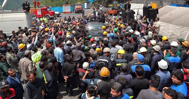 Miners at disaster site besiege Iranian president's car
