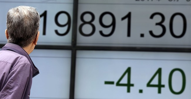 Asian shares mixed as China tightens market oversight
