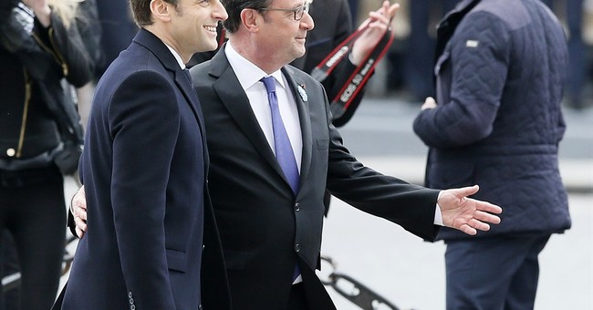 France's new head of state works on being presidential