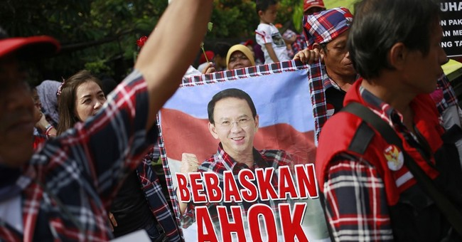 The Latest: Crowds mass at jail where Jakarta governor held