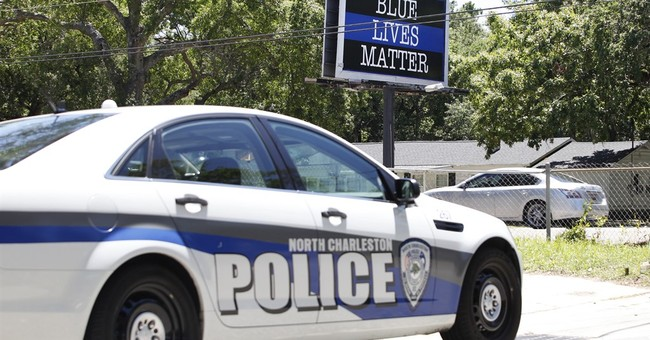 'Blue Lives Matter' sign put up near site of police shooting