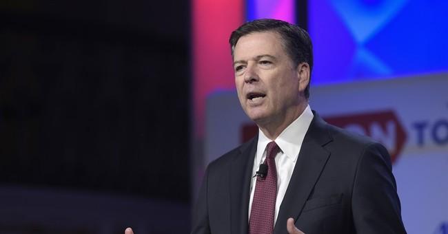 The Latest: FBI corrects Comey testimony on Clinton aide