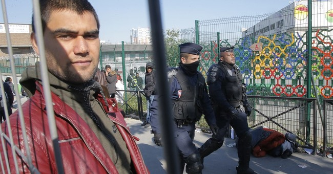 The Latest: Paris police move 1,600 from refugee tent camps