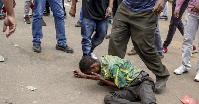 Rioters and police clash in Johannesburg protest