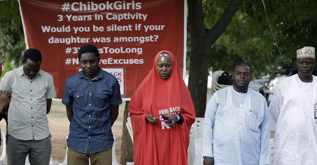 Parents of freed Nigeria schoolgirls still wait to see them