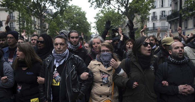The Latest: Niece of France's Le Pen quits politics for now