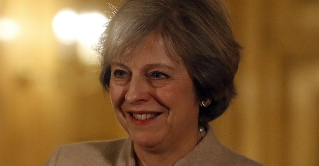 Lawmakers urge British PM May to clarify Brexit intentions