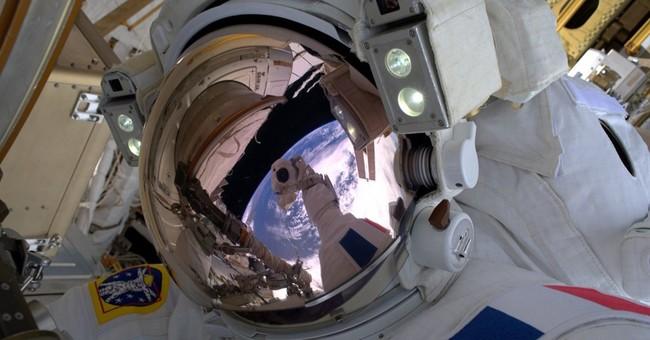 Spacewalking astronauts upgrade orbiting lab's power grid