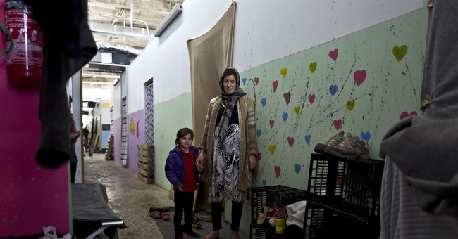 AP PHOTOS: Cold, filth take toll on migrant moms in Greece