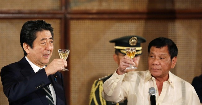 Japanese leader arrives in Australia to talk security, trade