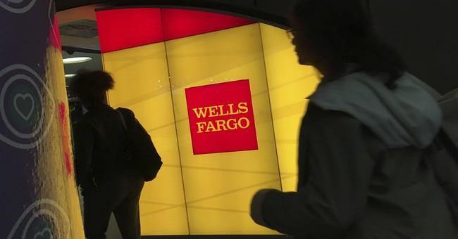 Wells Fargo profit falls after sales practice scandal