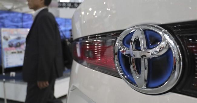 Toyota see profit drop on yen, president promises change