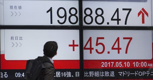 Global stocks, dollar edge lower after Trump fires Comey