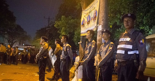 Myanmar police fire warning shots after religious tension