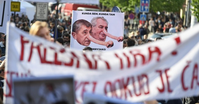 Czechs rally against country's president, finance minister