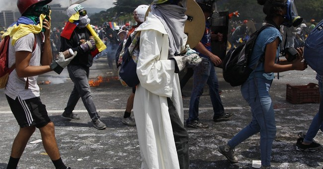 Dozens hurt, 1 dead in violent day of protests in Venezuela