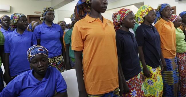 Parents of freed Nigeria schoolgirls still wait to see them
