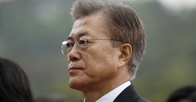 South Korea's Moon sworn in, says willing to go to North