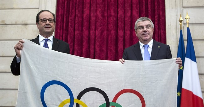 Macron talks up 2024 Paris Olympic bid to Bach