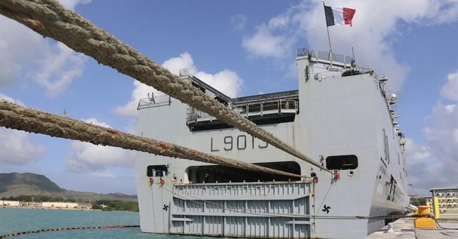 The Latest: Amphibious landing delayed at Guam drills