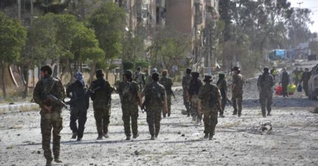 The Latest: Syrian Kurds seek 'neighborly' Turkey relations