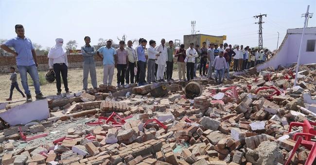 Wall falls onto guests at wedding in India, killing 24