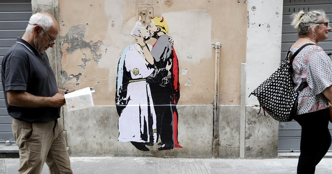 Poster of pope and 'devilish' Trump kissing appears in Rome
