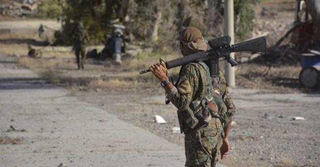 Turkey leader calls on USA  to reverse decision to arm Kurds