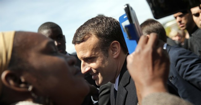 The Latest: Macron rejects former PM Valls as candidate