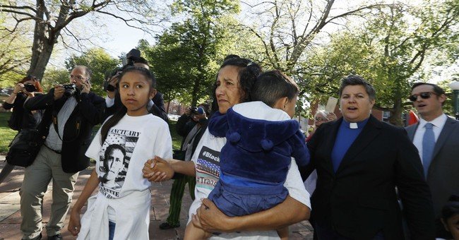 The Latest: Immigrant vows to fight for another in hiding