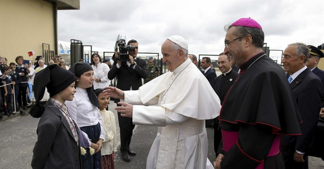 Pope cheered in Fatima to honor children who urged peace