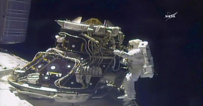Astronauts ace station's 200th spacewalk, shortened by leak