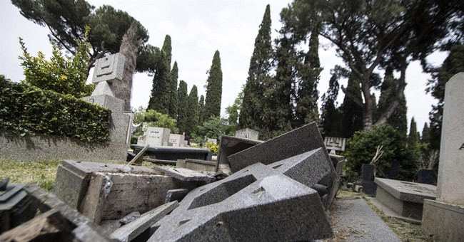 Nighttime vandals smash some 70 headstones at Rome cemetery