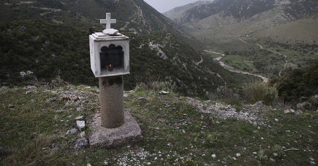 AP PHOTOS: Shrines mark tragedy on Greece's deadly roads