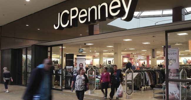 Losses at JC Penney double, sales slide, as do shares