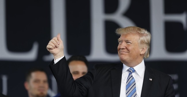 The Latest: Trump praises virtues of being an 'outsider'