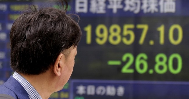 Asian shares gain, shrug off cyberattack, NK missile launch