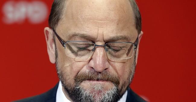 Merkel's party wins election in rivals' German heartland